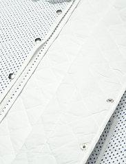 nué notes - Carly Vest - puffer vests - bijoo blue - 4