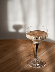 Orrefors - METROPOL COUPE - champagneglass - black - 2