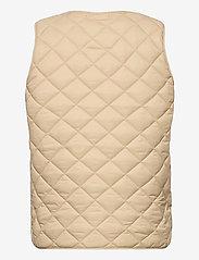 Part Two - HellenPW OTW - puffer vests - irish cream - 1