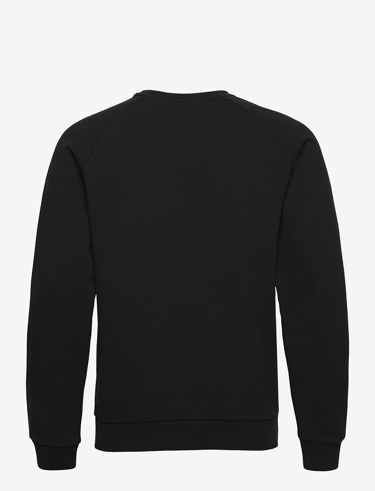 Peak Performance - M Moment Crew - sweaters - black - 1