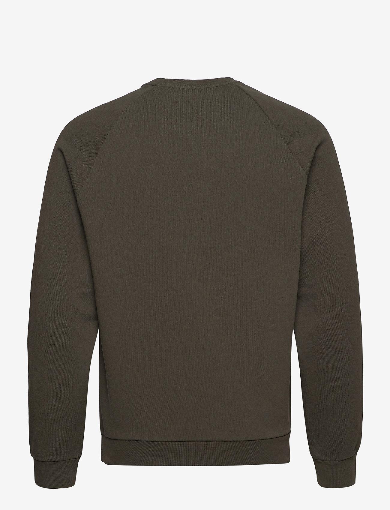 Peak Performance - M Moment Crew - sweaters - black olive - 1