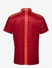 Peak Performance - Bandon Print Polo Men - paidat - clay red - 1