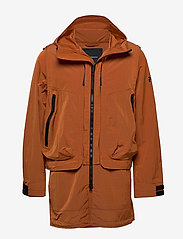 Peak Performance - M X.13 Combined Coat - insulated jackets - orange dune - 1