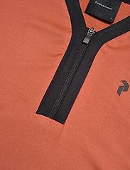 Peak Performance - Turf Zip SS Women - poloshirts - clay red - 2