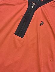 Peak Performance - Turf Zip SL Women - poloshirts - clay red - 2
