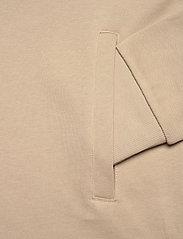 Peak Performance - M Stowaway Hood - hoodies - celsian beige   black - 3