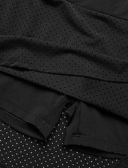 Peak Performance - W Trinity Skirt - urheiluhameet - black - 2