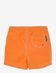 Polarn O. Pyret - Swimwear Pants Solid - badehosen - russet orange - 1