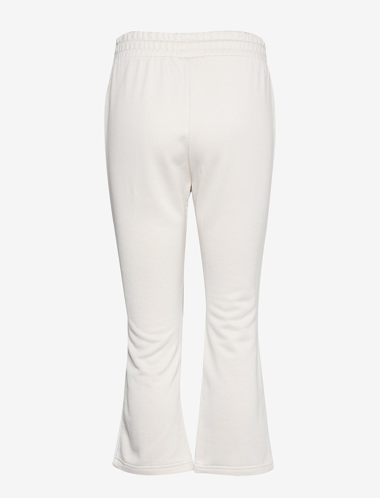 PUMA - Classics Kick Flare Pant - pants - pastel parchment - 1