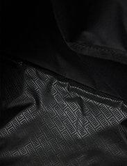 PUMA - Fundamentals Sports Bag M - torby treningowe - puma black - 4