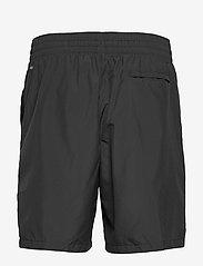 PUMA - First Mile Woven Short - chaussures de course - puma black - 2
