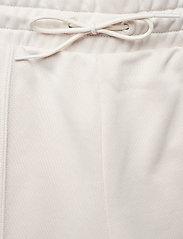PUMA - Classics Kick Flare Pant - pants - pastel parchment - 4