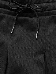 PUMA - Classics T7 Pleated Skirt - sports skirts - puma black - 4