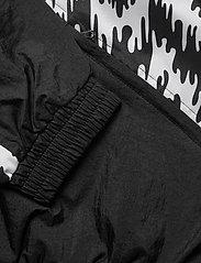 PUMA - TFS OG Track Jacket AOP - track jackets - puma black - 4