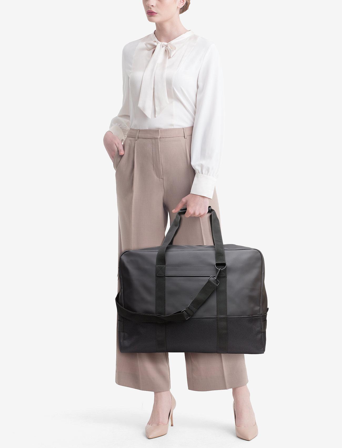 Rains Luggage Bag - 01 BLACK