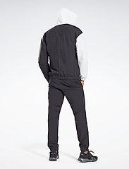 Reebok Performance - Woven Track Suit - dresy - black - 5