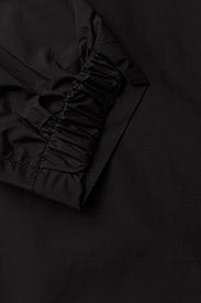 Rosemunde - Cape - manteaux de pluie - black - 4