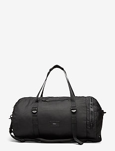 HANNES - weekend bags & suitcases - black