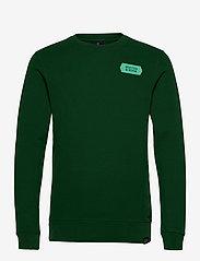 Scotch & Soda - Crewneck sweat with subtle chest artworks - basic sweatshirts - jungle green - 0