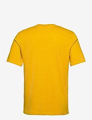 Scotch & Soda - Seasonal artwork tee - short-sleeved t-shirts - explorer yellow - 1