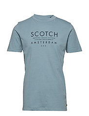 Garment-dyed tee with clean chest logo artwork - BLUE ICE