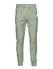 Technical sweatpant with rubber badge - SAGE