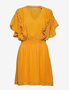 Lace dress with ruffles and pom-poms - SUNGLOW