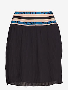 Pleated skirt with 'Maison Scotch' elastic waistband - BLACK