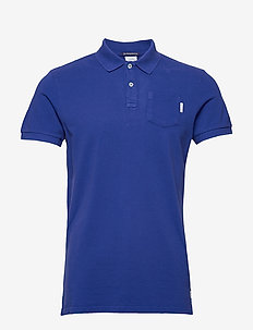 Blauw garment dyed polo - kortærmede - yinmin blue