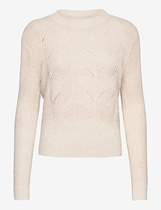Fuzzy knit with cable stitches - pulls - ivory melange