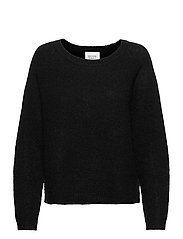 This knit is made from a soft mohair and wool blen d and has - BLACK
