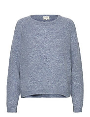 This knit is made from a soft mohair and wool blen d and has - BLUE BONNET