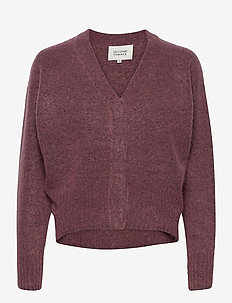 This cardigan with deep V-neck is made from a soft  mohair-w - gensere - desert sand