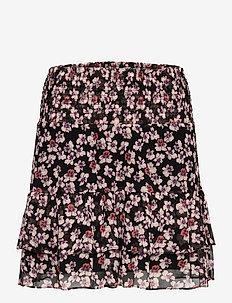Beautiful printed mini skirt in a viscose quality. The skirt - black