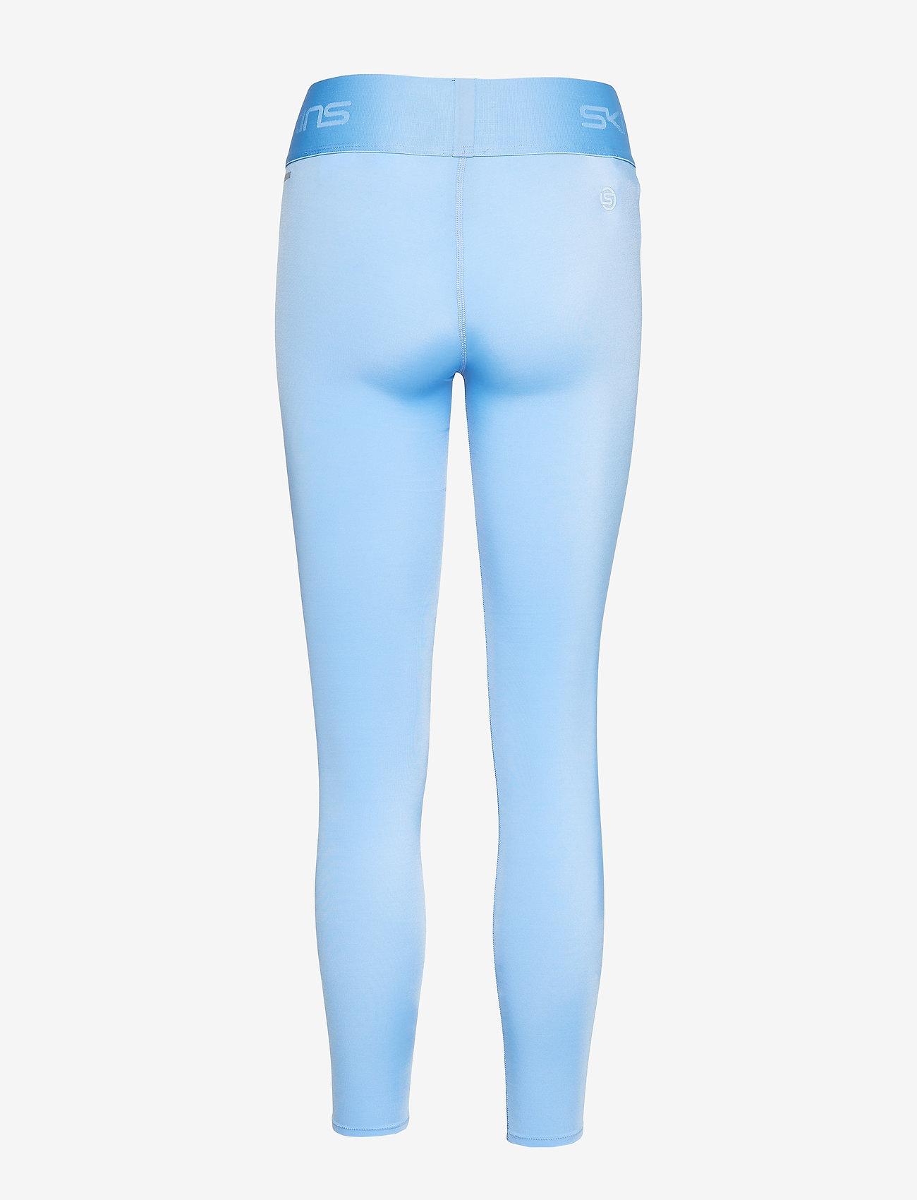 Skins DNAmic Primary Womens Long Tights - Leginsy SKY BLUE LOGO - Kobiety Odzież.
