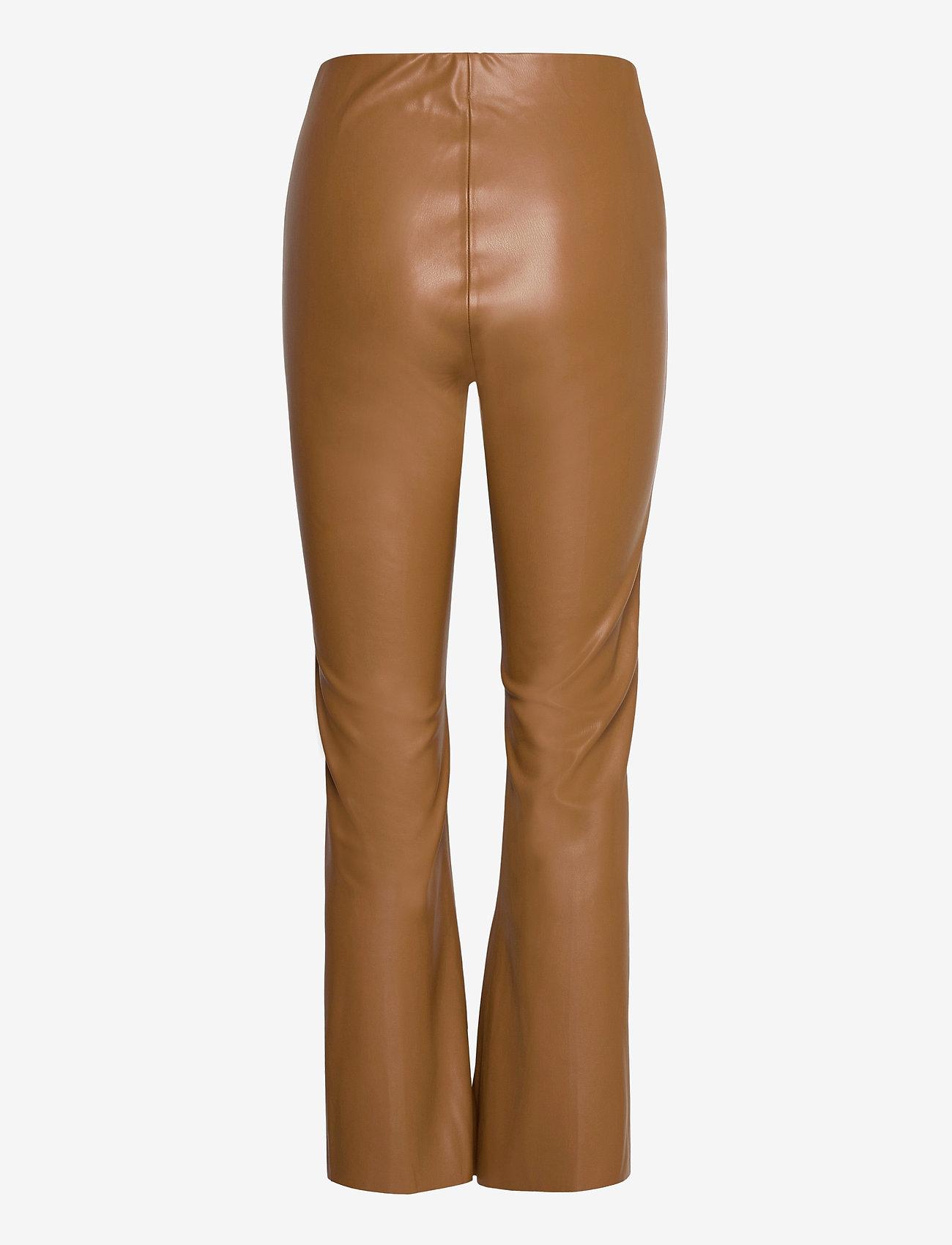 Soaked in Luxury - SLKaylee PU Kickflare Pants - skinnbyxor - rubber - 1
