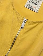 Superdry - NEVADA HALTER PLAYSUIT - buksedragter - oil yellow - 2