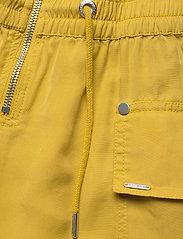 Superdry - NEVADA HALTER PLAYSUIT - buksedragter - oil yellow - 3
