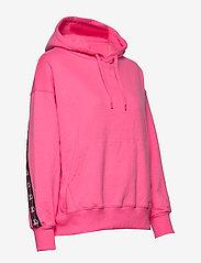 Svea - Janet Hood - bluzy z kapturem - neon pink - 3