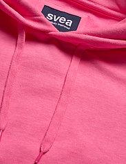 Svea - Janet Hood - bluzy z kapturem - neon pink - 4