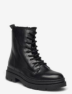 Woms Boots - flache stiefeletten - black