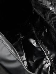 Tenson - Travel bag 35 L - sacs de sport - black - 4