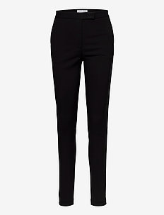 TAIKA - trousers with skinny legs - black