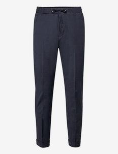 TRAVIN - spodnie na co dzień - light ink