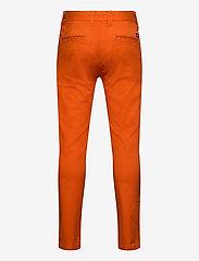 Tommy Hilfiger - ESSENTIAL SLIM CHINO TH FLEX - trousers - bonfire orange - 1