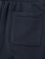 Tommy Hilfiger - ICONS SLIM LOGO SWEATPANTS - sweatpants - twilight navy - 4
