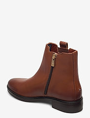 Tommy Hilfiger - TH INTERLOCK LEATHER FLAT BOOT - flat ankle boots - pumpkin paradise - 2