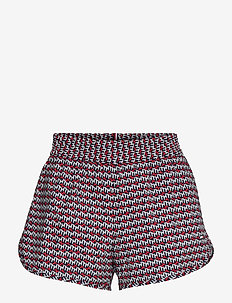 REGULAR AOP STRETCH WOVEN SHORT - träningsshorts - th cube all over red