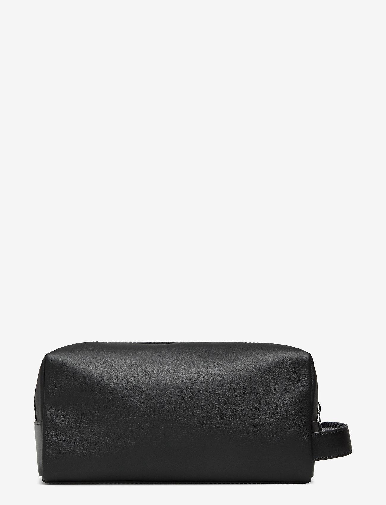Tommy Hilfiger - LEATHER WASHBAG - bum bags - black - 1