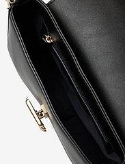 Tommy Hilfiger - TH LOCK CROSSOVER - crossbody bags - black - 4
